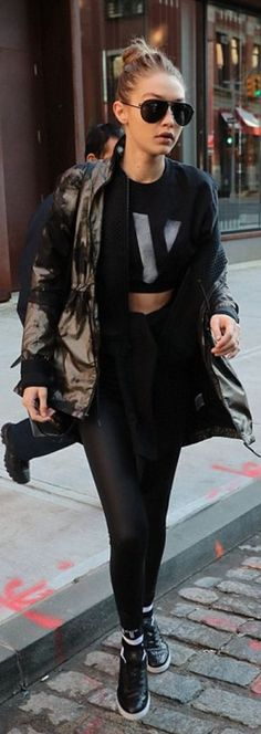Who made Gigi Hadid's black leather backpack, coat, aviator black sunglasses, sneakers, leggings, and jacket?