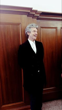 Peter Capaldi leaning against a wall