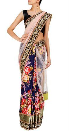 Sabyasachi - Malmal floral print sari with a blush pink net pallu and arjun border.