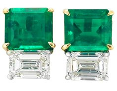 Pair of Emerald and Diamond Earrings.  18 kt. yellow and white gold, centering 2 emerald-cut emeralds approximately 2.78 cts., and 2 emerald-cut diamonds approximately 1.48 cts. Via Doyle New York.