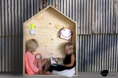 Wooden house for kids room to read and play