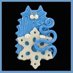*SORRY, NO INFORMATION AS TO WHAT MATERIAL USED.  Blue Snowflake Kitty Cat Pin by artsandcats, via Flickr