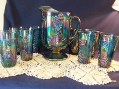 Other Pinner said. My first Carnival glass purchase was Blue Indiana Harvest Grape pitcher and six tea glasses like these! Fenton Glassware, Antique Glassware, Vidro Carnival, Antique Dishes, Vintage Dishes, Blue Harvest, Blue Carnival Glass, Vintage Carnival, Glass Company
