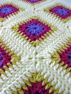 No pattern, but the colors & the way the squares are joined is beautiful!