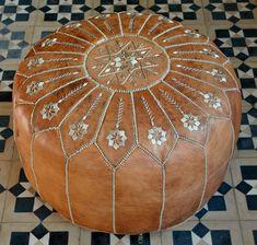 Gorgeous Moroccan Leather Pouffe with intricate embroidery. I sell these and other Moroccan treasures on my website www.beyondmarrakech.com