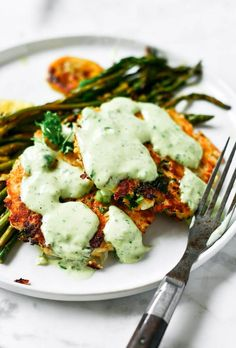 Zesty herb salmon burgers with lemon asparagus and tzatziki sauce! An easy and delicious whole30 meal that is ready in 20 minutes!