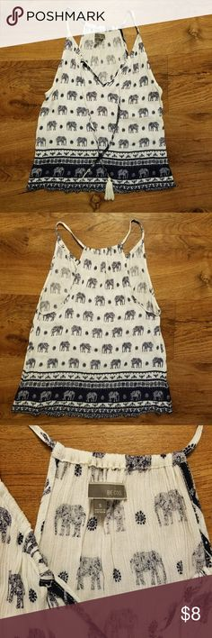 Elephant print tank top White and navy tank top. Really cute elephant pattern. Almost scarf like feel. Perfect for hot summer days. It is missing a tassel. Tops Tank Tops