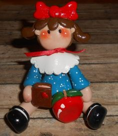 School Girl [CL-77] - $18.00 : Debbies Craft Corner!  School Girl   All dolled up and ready to go! She has her book and an apple for the teacher.  Approx. 3 inches tall  Handcrafted from Polymer Clay.  Baked and glazed just for you.  No two are alike.  Choice of colors.