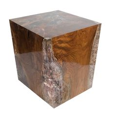"""View The Entire Collection DIMENSIONS 16"""" x 16"""" x 20""""H. Custom sizes available. COLORS Shown: Natural teak with clear resin Custom stains and finishes available: Teak: Bleached, Natural, Brown or Espresso Resin: Clear, Mint, Amethyst or Aqua DESCRIPTION The cracked resin side table is made from teak infused with resin. A dramatic piece due …"""