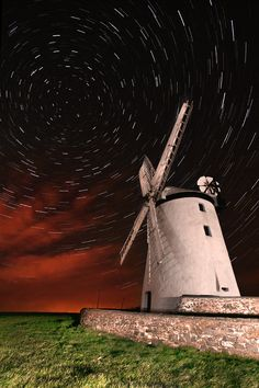 Solar Wind - This was a series of 30 sec exposures lasting about 50mins then blended in Startrails software. The red in the sky was city lights and passing cloud during part of the duration. Ballycopeland Windmill is a functioning windmill located one mile west of Millisle, County Down, Northern Ireland. It is managed by the Northern Ireland Environment Agency and is open to the public.