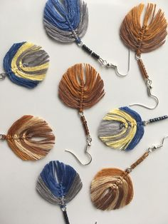 Settled colourways with combination of tiny glass beads. Love their gentle look. #macramefeathers #macrameleaves #diyearrings # handmadeinswitzerland #makrameohrringe #macramefeder #makrameblat #handgemachteohrringe