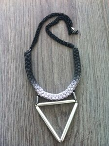 A unique macrame necklace with lila cord , and silver triangle shape tubes . There are black chains on top and I spray painted the necklace with black color (ombre). This macrame pattern is trade mark of Artemis Art Handmade Collection.