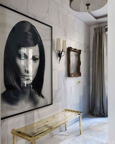 Jean Louis Deniot's Apartment in Elle Decor; art, gold bench, marble
