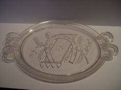 "Pattern Glass EAPG bread plate double horsehoe handles and fancy in center old  15 "" x 10"", bread plate embossed, horseshoe and carpet and wheat heads in center & other fancy borders, double horseshoe handle with anchor and rope on each end.  SOLD $31.10"