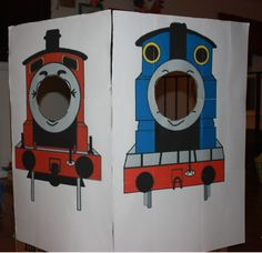 Diy Thomas and James face cut out Photo booth made by enlarging and printing Thomas and James pictures and printing them out on 9 sheets of card stock and sticking them onto a large cardboard box and cutting the faces out.