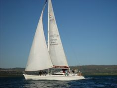 Garden Route Sailing Charters - The Garden Route is a stretch of coastline that runs from Mossel Bay in the south to Port Elizabeth in the north. This popular route offers a mild climate, long stretches of beach, lakes, mountains and lush indigenous forests. The Garden Route is also home to unique marine reserves, where soft coral reefs, dolphins and seals abound. The endangered southern right whale come here to calve in the winter and spring.