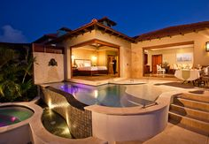 The Sunset Bluff Millionaire Butler Villa Suite w/Private Pool Sanctuary at night. Sandals Saint Lucia