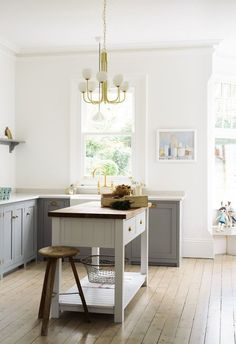 It's OK to take a country style kitchen in mix in some fun contemporary lighting