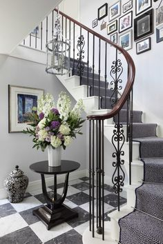 nero marquina staircase traditional with gallery wall oriental hall and stair runners House Design, Staircase Decor, Staircase Railings, Staircase Design, Hall And Stair Runners, Foyer Decorating, Luxury Staircase, Stair Runner, Stairs