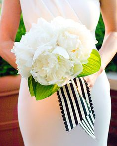 White peonies are wrapped with striped vintage ribbon, befitting of a black-and-white wedding.