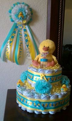 """Diaper """"cake"""" from a Rubber Ducky Baby Shower #babyshower #diapercake Maybe a different animal, with a neutral color scheme. Description from pinterest.com. I searched for this on bing.com/images"""