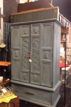 Destiny Decor Furniture:  A large armoire painted a custom blue with two color glaze.