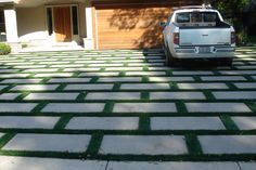 Who says a drive way has to be plain and boring? Combine concrete and EasyTurf artificial grass for a one of a kind, luxurious look! www.easyturf.com l fake grass l front yard l outdoor living