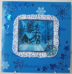 blue xmas on Craftsuprint designed by Gail Collins - made by Chell Sharpe - I printed out the sheet onto 220gsm good quality photo paper. I matted the base image onto blue holo card, then onto silver mirror card, added some Lace