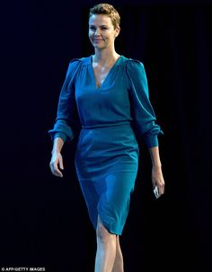 Charlize Theron looks back to her best as she shows off longer pixie crop at the World Economic Forum
