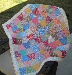 Colorful baby quilt (love the tumbler style).