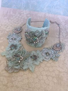 Lace neckace and cuff, hand dyed aqua lace, embellished with crystals, sequins and seed beads. Thanks, Kristin :) Fabric Flower Necklace, Embroidery Jewelry, Statement Jewelry, Fabric Flowers, Seed Beads, Crochet Necklace, Felt, Textiles, Crystals