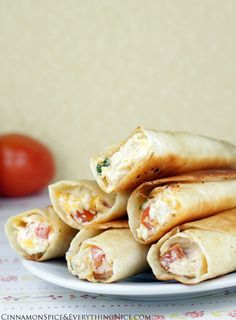 Chicken and Cream Cheese Taquitos ~ Tortillas rolled with a shredded chicken, cream cheese, cheddar, salsa and spinach filling... They have an addicting crunch that gives way to creamy, cheesy insides that will turn these into fast favorites.