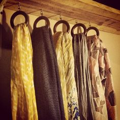 Scarf hanger: shelf, curtain rings, cup hooks. Problem...who's gonna hang that shelf?... :)