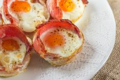 Bacon wrapped in each muffin cup around the sides,with an egg in each cup