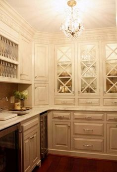 lovely white cabinets, like the criss cross on the glass