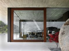 ::ARCHITECTURE:: Pitch's House by Inaqui Carnicero  Fantastic blend of large glass doors and  stone (or cement)