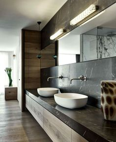 Condominium that overlooks the Lugano Lakeshores in Switzerland - vanity, sinks, stone, lighting. Nice!