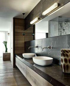 Condominium that overlooks the Lugano Lakeshores in Switzerland - vanity, sinks, stone, lighting. Nice!