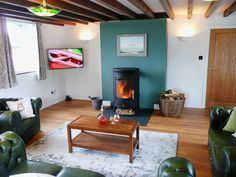 The living room at Stable Cottage with a real fire