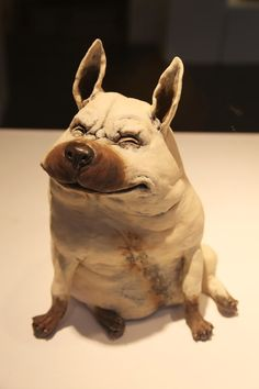 This great little ceramic dog sculpture didn't have a credit but thanks to the comment below the maker is Christina Rosén http://www.christinarosen.com