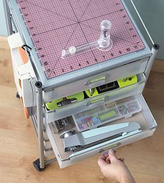 Scrapping on the Go - This modular storage system makes it super easy to move your supplies where you need. From small tools to paper, this storage unit can hold it all, then roll into the closet once you're done scrapbooking.