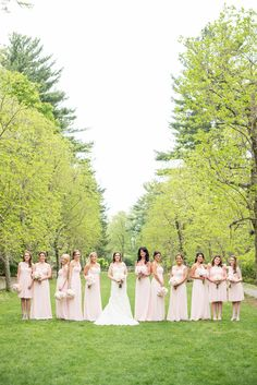 Wedding party with bridesmaids in blush pink. Photos at a Skylands Manor wedding. Images by Mikkel Paige Photography, NJ wedding photographer. #blushbridesmaids #bridalparty #uniquebridalpartyphotos #lightpinkgowns