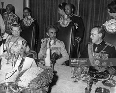Emperor of Ethiopia Haile Selassie I (1892 - 1975, centre) with his guests Queen…