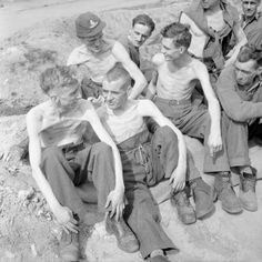 """Emaciated Allied POWs from Stalag XI-B are photographed shortly after their liberation by British troops of """"B"""" Squadron, 11th Hussars (Prince Albert's Own) Army calvary regiment and the Reconnaissance Troop of the 8th King's Royal Irish Hussars...."""