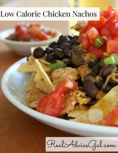 This Low Calorie Chicken Nachos Recipe is perfect for game day, whether your game is football, basketball, or like us, soccer. It may be light on calories but it it bold of flavor and taste.