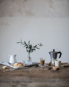 Love the vase, juxtaposed with coffee ritual.