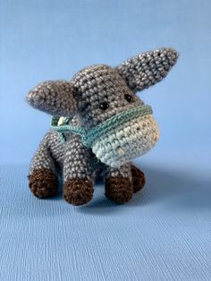 This donkey is a part of a large Nativity scene, all in amigurumi style. You can find the complete pattern Cute Donkey, The Shepherd, Rodents, Photo Tutorial, Pet Store, More Pictures, Sheep, Nativity, Dinosaur Stuffed Animal