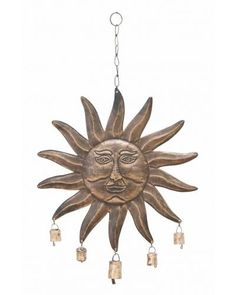 Sun Face Outdoor Copper Wind Chime With Five Bells - This hanging SUN FACE WIND CHIME comes with five small bells. The sound of these bells is so melodious that you and the guests like to hear it again. Beautiful wind chime with SUN FACE is designed in round shape with rays all around. Just wait for the light wind and feel the blessings of Sun God.