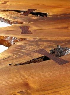ahhhhh Nakashima....  9 Butterfly joints are in delicate contrast to the highly figured and natural wood