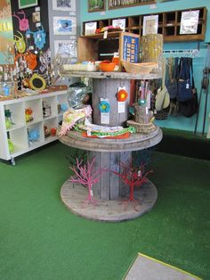 Large wire spool display at Yellow Umbrella, a handmade gift shop in Bemidji, MN!